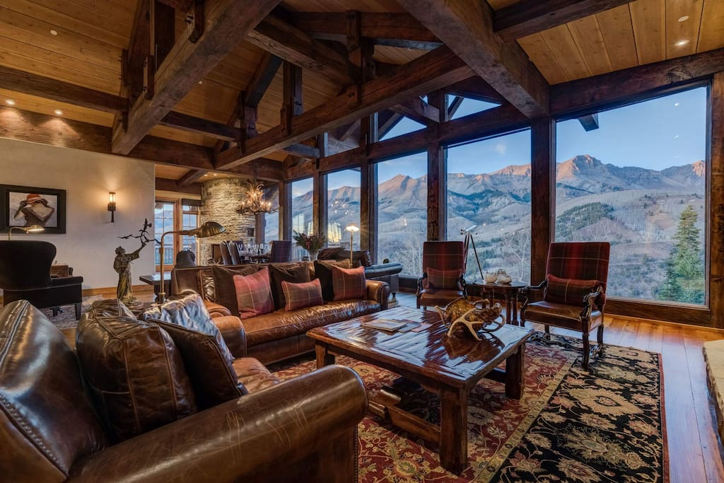 The exposed beams above the living area provide a rustic touch to an exquisite design.
