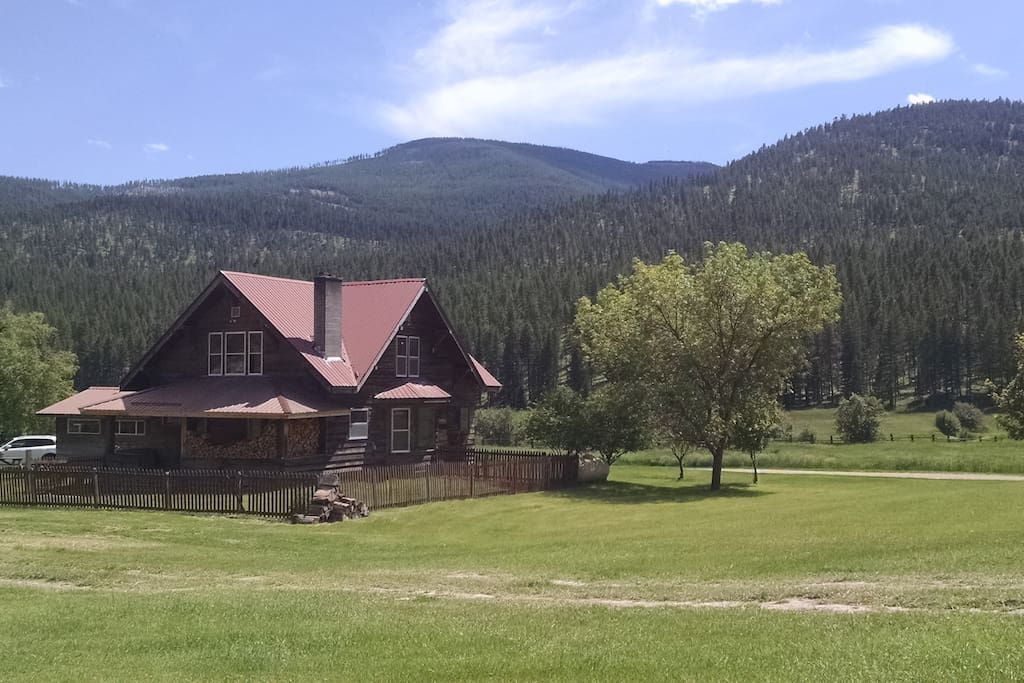 house with Mount Haskill in background, 3100 feet up over 4.5 miles