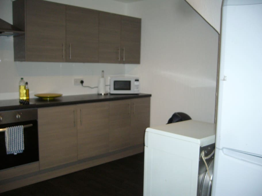 Well equipped kitchen including dryer & fridge freezer