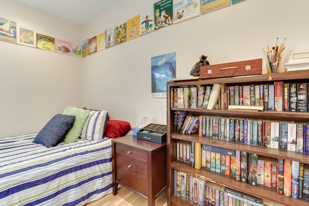 Queen size bed in quietest room in house, full bookshelf and games supplied