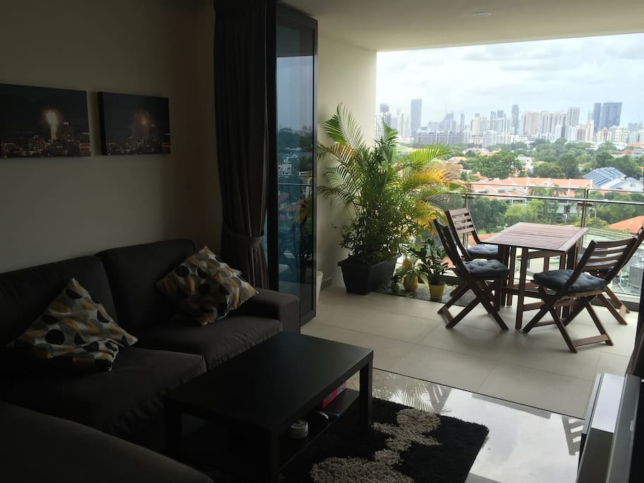 Living room with cable TV, extends out onto balcony
