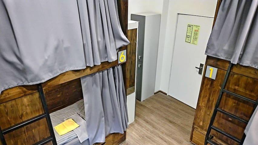 Bed in 6-bed men-only dorm shared bathroom on the floor