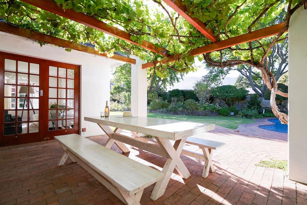Shaded Pergola with garden & mountain views