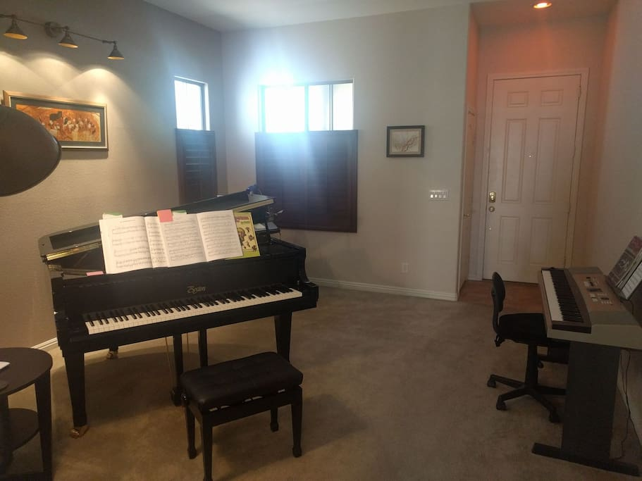 The music room is the first room you'll see. If we're not asleep, please feel free to play the piano!