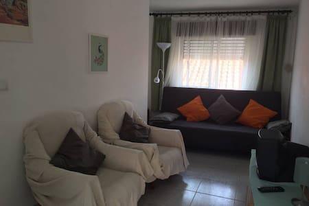 Apartment in a village near the beach