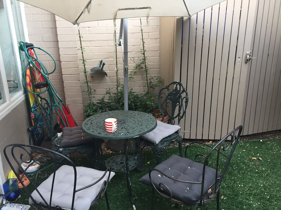 Good sized courtyard with chairs and table