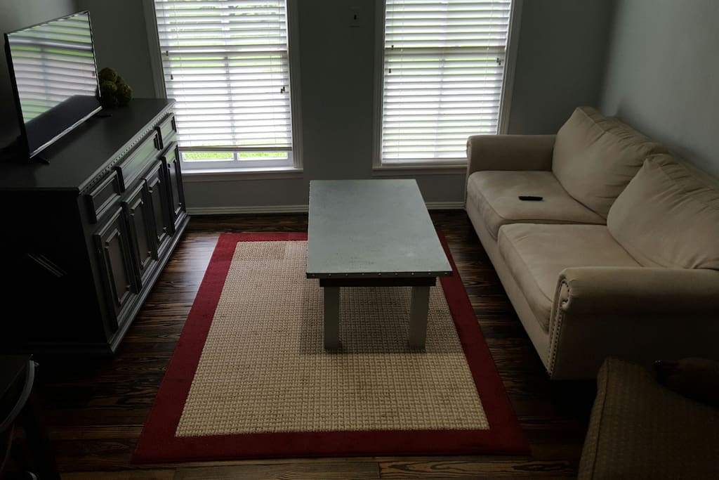 Living room, tv, couch, chair, coffee table, mini table with chairs