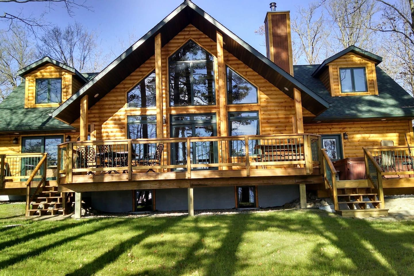Shared - The windows reflect the trees and lake you have just come from with a deck welcoming you back.