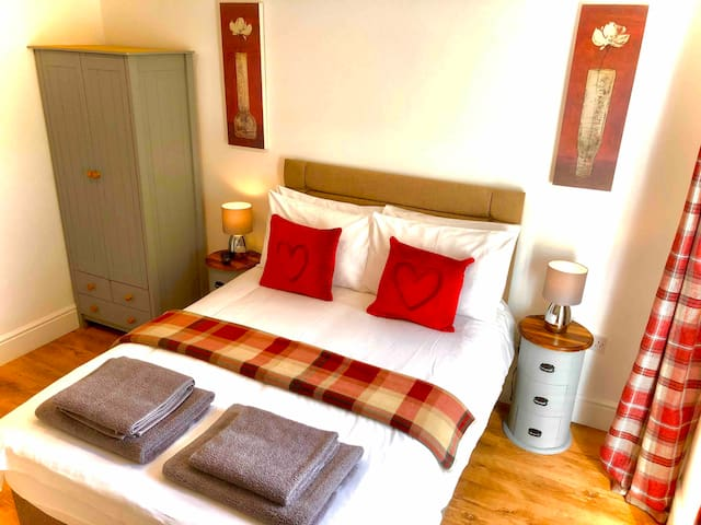Main bedroom also has a chest of drawers, chair and tv