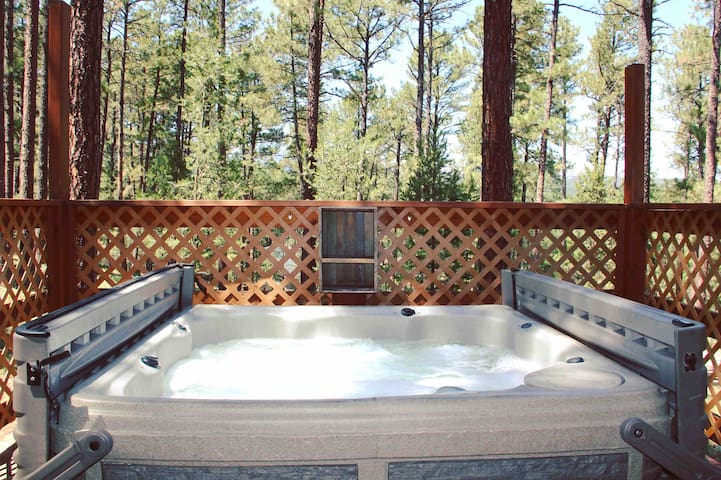The hot tub is ALWAYS welcoming. It fits 4 adults comfortably. There are hooks on the deck available for hanging towels and a double shelf to keep your personal items out of the weather! We love to hook up our bluetooth speaker and star gaze.