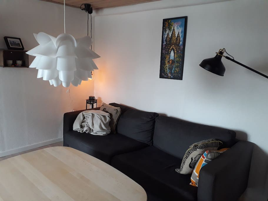Living room with sofa and nice atmosphere and cosy lighting