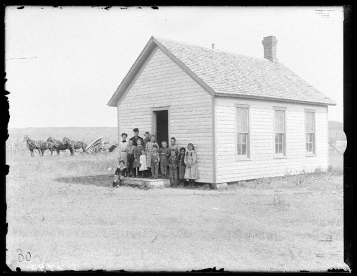 Center School District 185, circa 1892.   (Solomon Butcher Photo)  If you look closely at the reaper, you will see a man sitting on it, dressed to teach his students.  It originally stood about 4 1/2 miles SE of Callaway, NE... moved here in 2010.