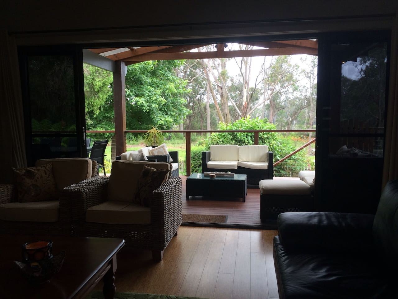 Lounge area looking towards the back deck, garden and National Park