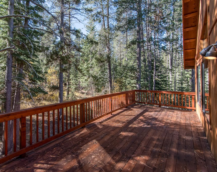 Step out to the expansive deck and enjoy the fresh mountain air amid the beauty of the surrounding pines.