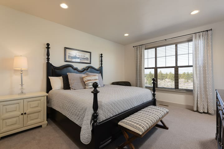 Main floor large master bedroom with super comfortable chaise perfect for watching mountain sunsets
