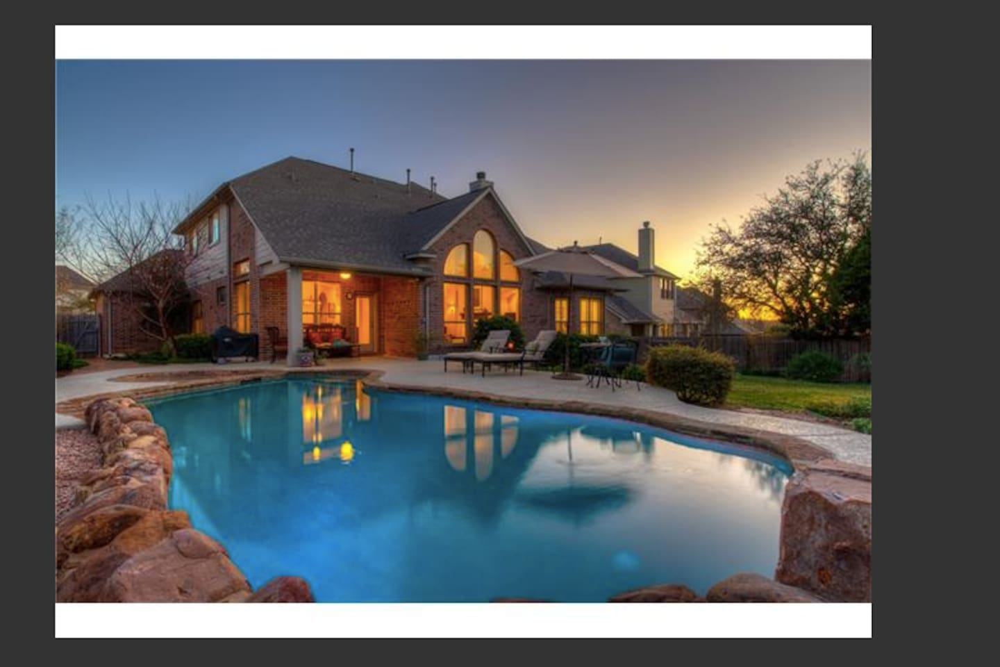 Povate back yard with gorgeous landscaping, large heated pool & spa