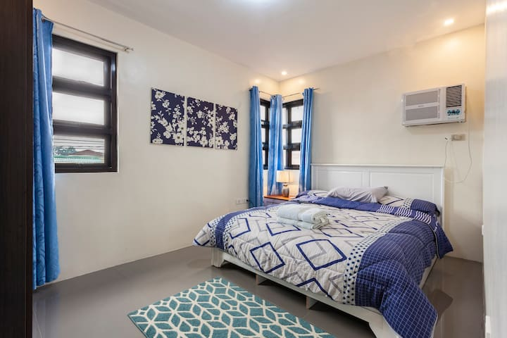 Clean beautiful locked two private bedrooms with queen sized beds and remote controlled A/C.