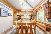 Sprawling dinning room table, this home is built with Doug Fir huge logs, this is the real deal, not a prefab kit