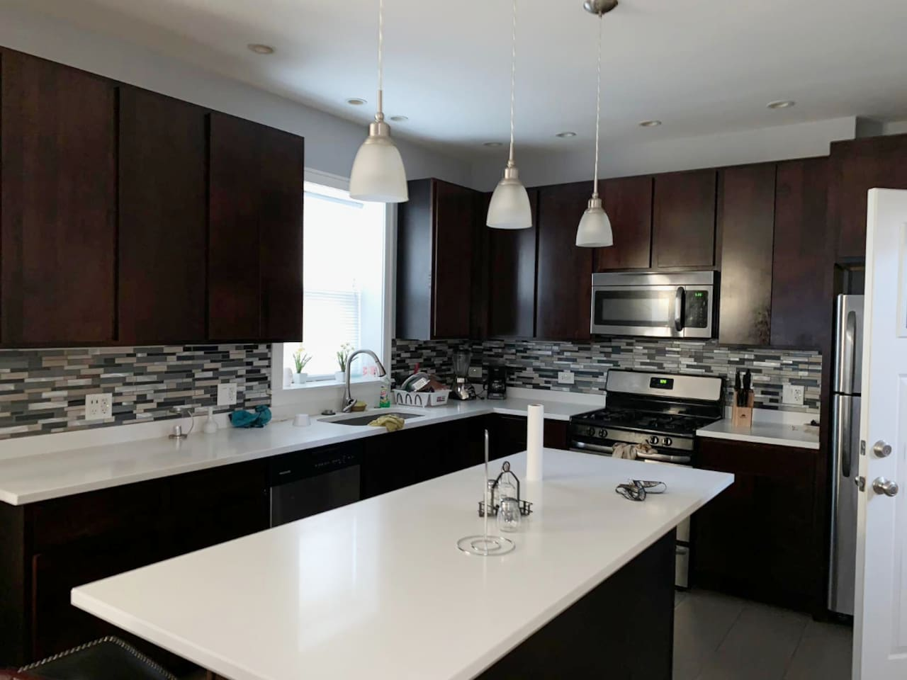 This Kitchen is one flight above the Private Guest Suite level. This Kitchen is SHARED w/ other guests. Please understand the listing doesn't come w/ 24hr maid service, please respect your other guests by cleaning after yourself in the shared areas.