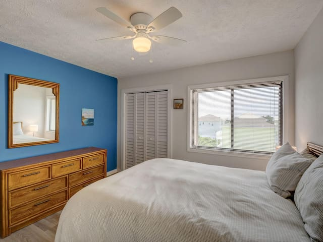 Large bed in master bedroom.