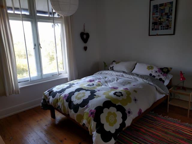 Front queen-sized bedroom