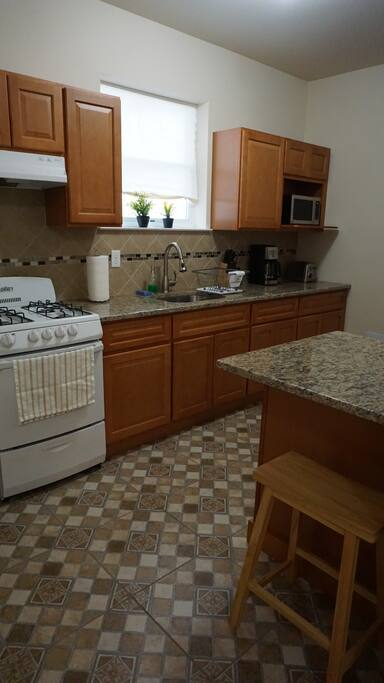 Full kitchen available. The cabinets have all the basics: plates, cups, cutlery, pots, pans, etc.