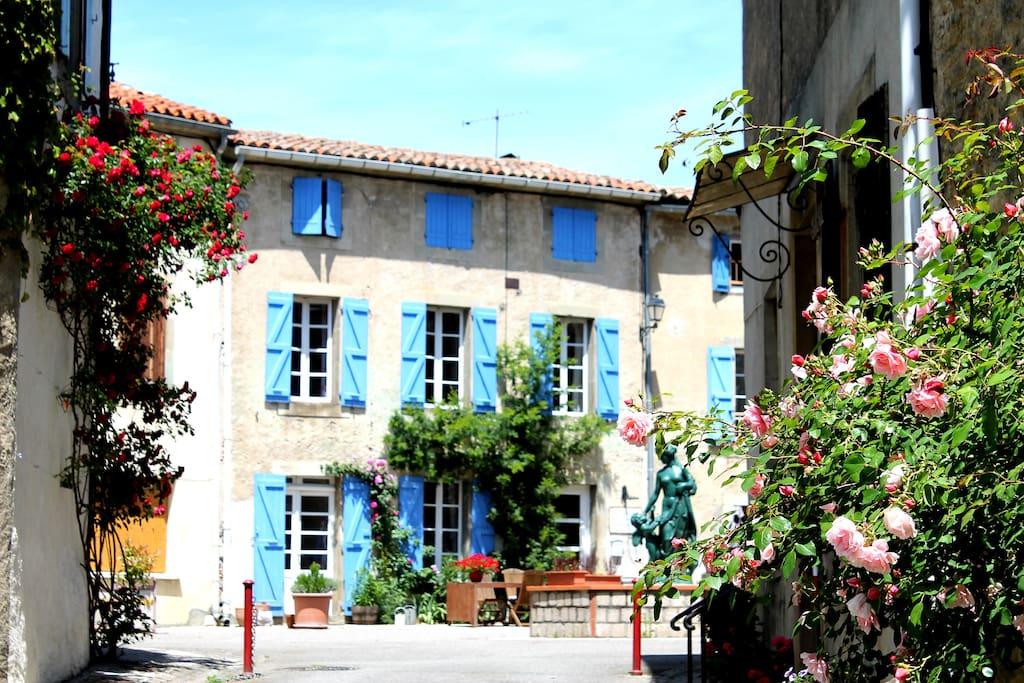Chez Maison Bleue on the beautiful village square