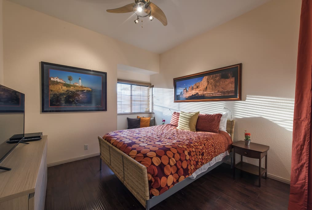 Large bedroom, Comfortable Queen bed, and a large TV.
