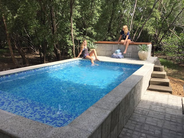 Solar powered, salt ionizing pool
