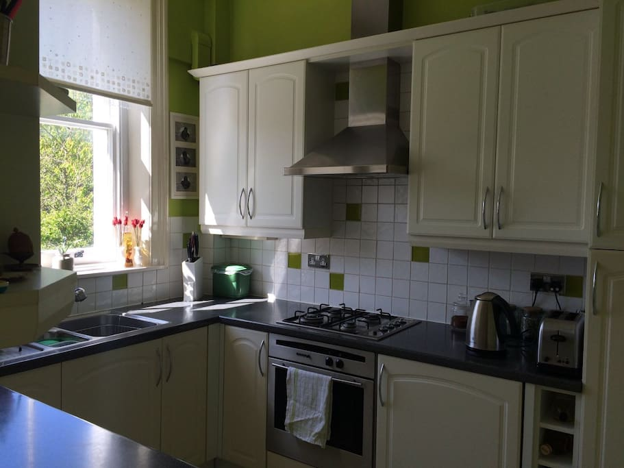 Fully fitted kitchen with integrated appliances, gas oven, microwave and fully equipped with pots, utensils and crockery.