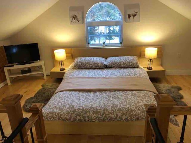Master bedroom on mezzanine (open concept)