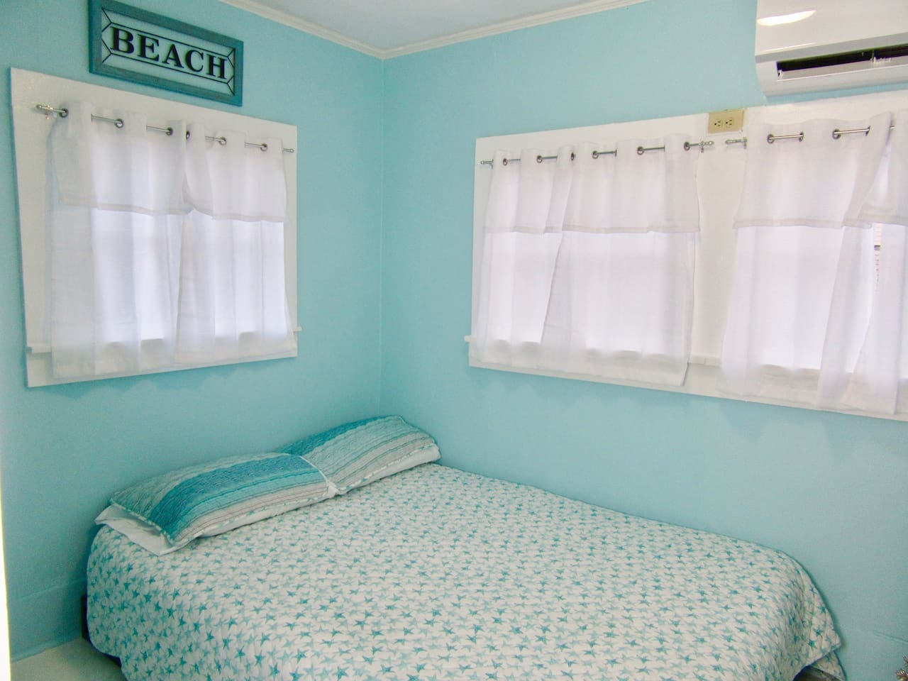 Cozy beach style bedroom with closet space