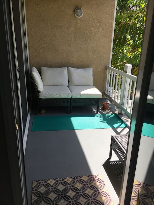 These cushions separate and there's room for 2 comfortably.  Yoga mat is inside and all yours to enjoy during your stay.