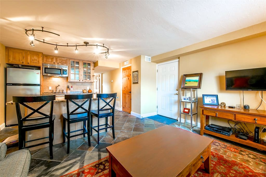 The condo features a large bedroom, full bathroom and fully furnished living room that opens up to the modern kitchen with stainless steel appliances.