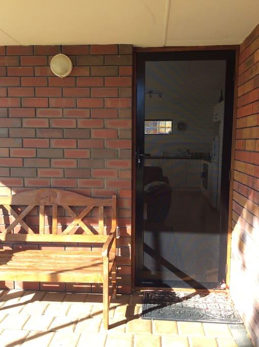 Front security door alongside bench seat.