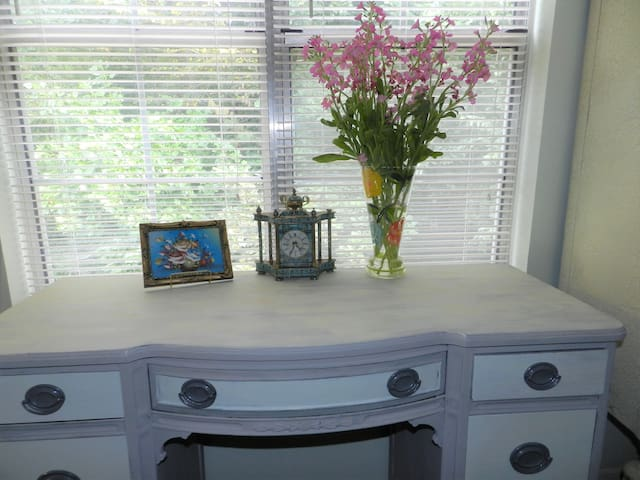Hand-painted desk looks out on the Chattahoochee National Forest and the back of the town house