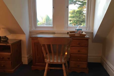 Private room in family home - female only