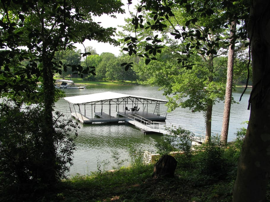 covered dock with deck and swim ladder