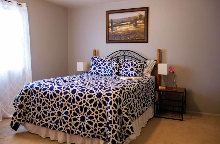 Blue bedroom. Pillow top premium mattress, large closet, and a dresser for clothes.