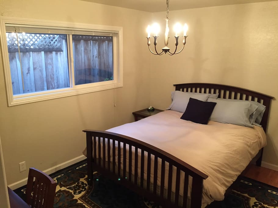 Pleasant room with a comfy Queen Bed, full size closet, and window overlooking the back patio.
