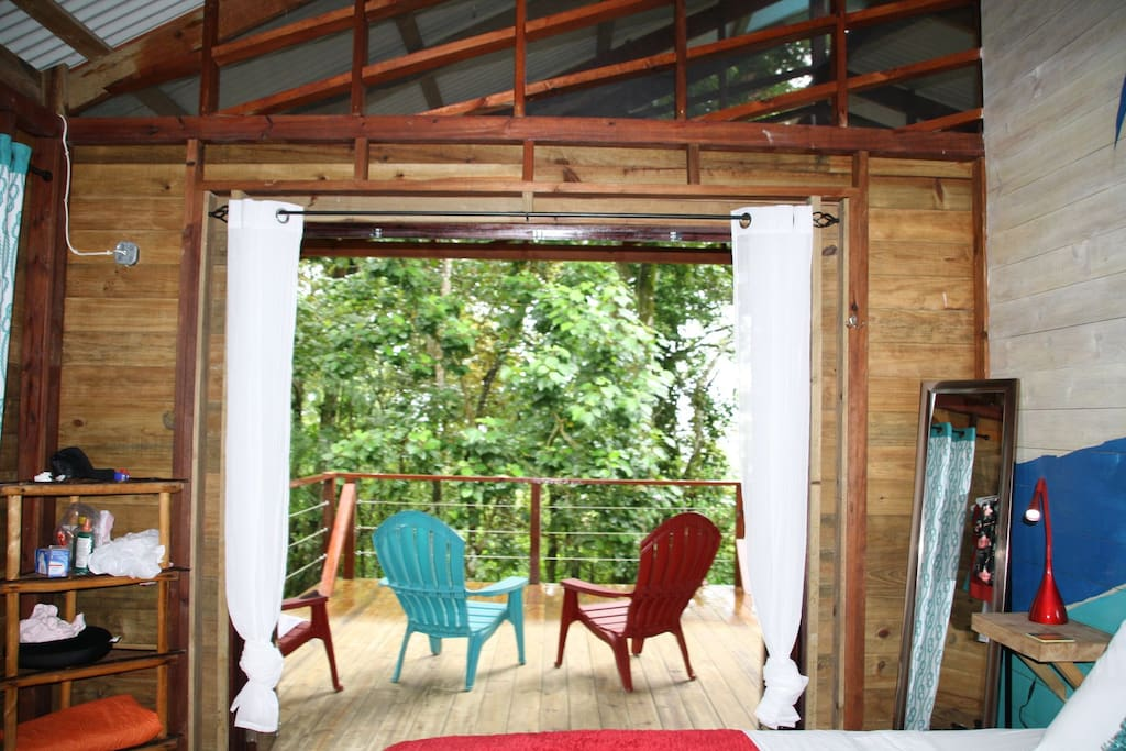 View out of the 4 paned glass doors  onto your outdoor seating area.