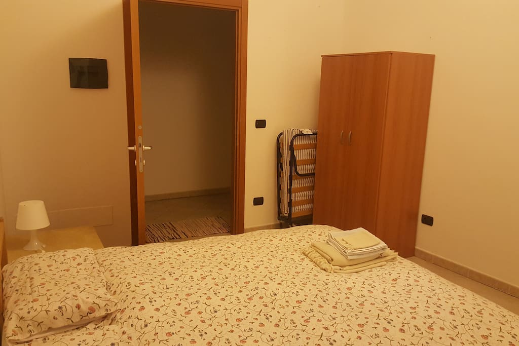 The room is located on the ground floor and equipped with a dresser, table, two chairs, double bed and even a extra bed if there is a child or third person. The bathroom is right across the hall.