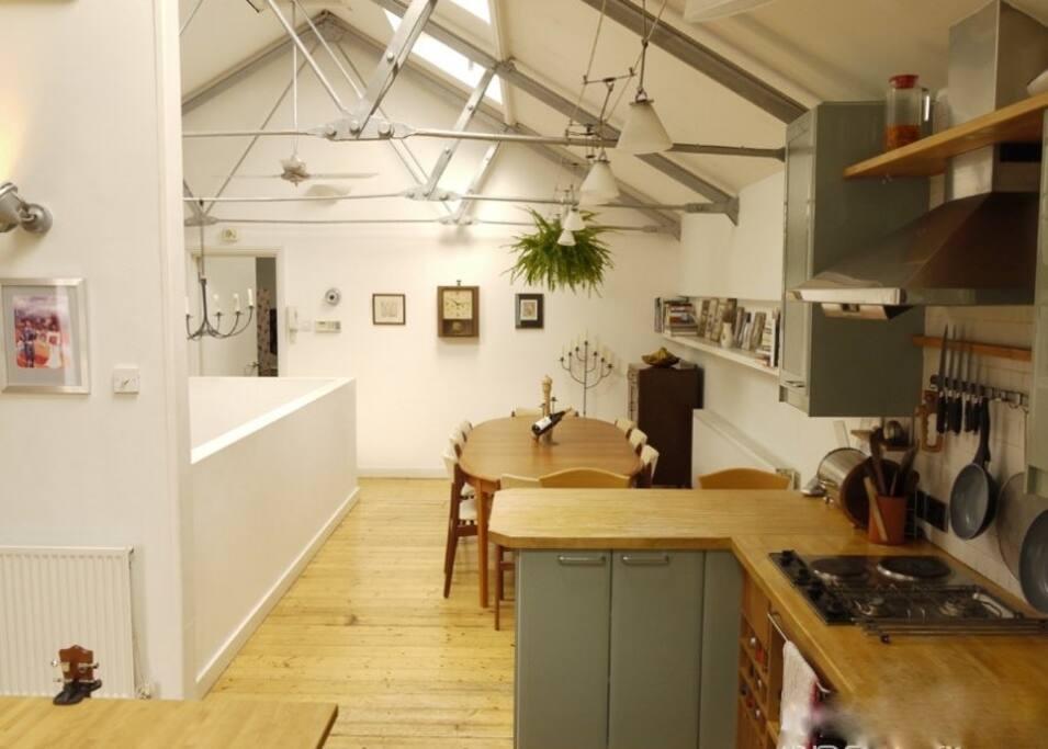Open-plan loft: kitchen, diner (table seats 8-12), skylights, roof-terrace