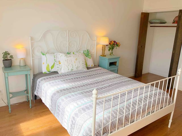 Bright, clean and beautiful queen bedroom.