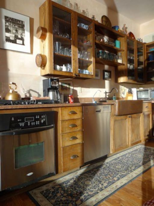 Fully Equipped Kitchen. Modern appliances and copper farm sink