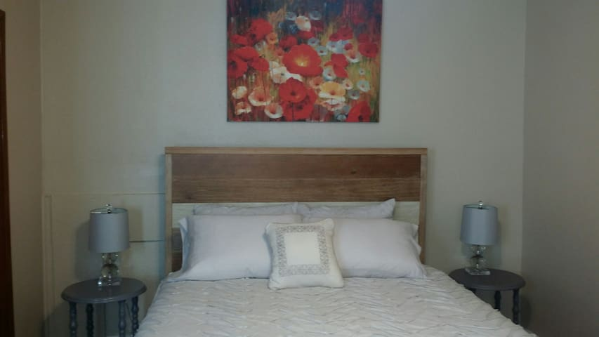 Brand new queen bed and side tables