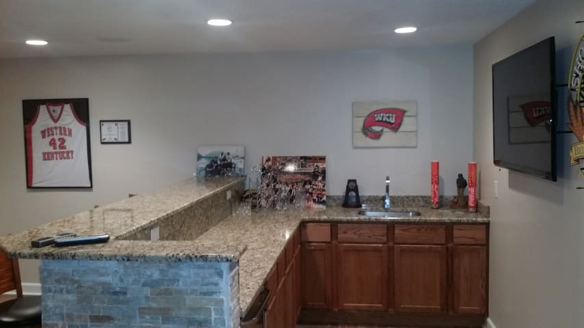 Basement Bar. 55 inch HD flat screen, sink, fridge, granite countertops