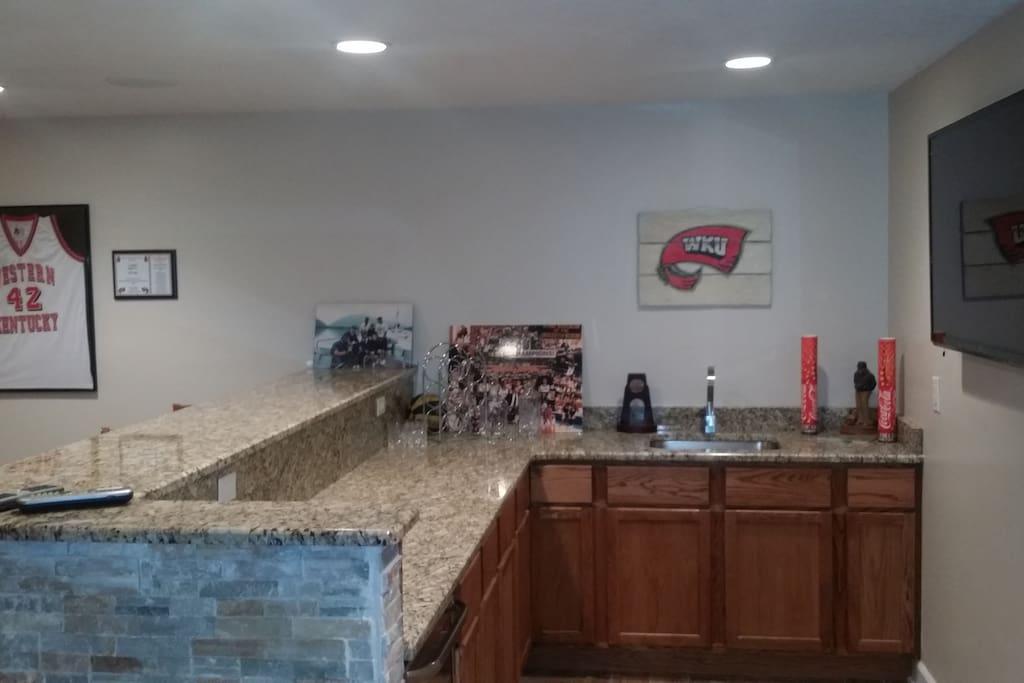 Basement Bar. 55 inch HD flat screen, sink, fridge, granite countertops