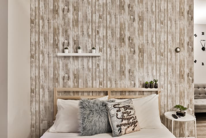 Beautiful wooden wall ( wall paper ) and confortable bed