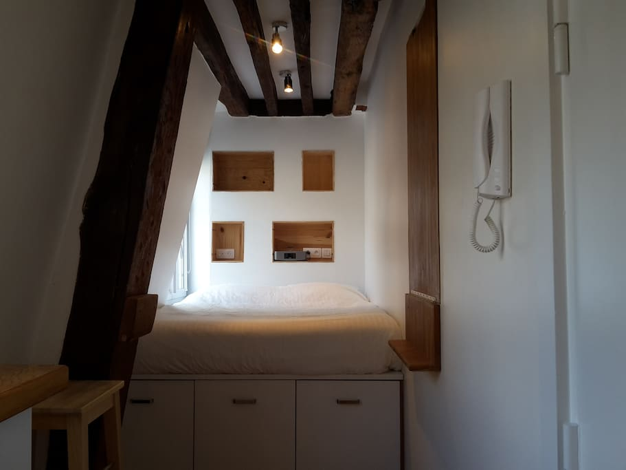 Designed like a boat cabine, every inch of this tiny studio has been optimised. Under the bed is a pull-out cupboard, and space for suitcases.